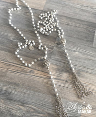 Bead necklace with chain tassel