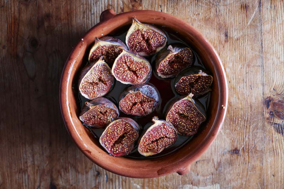 Roasted figs in terracotta bowl