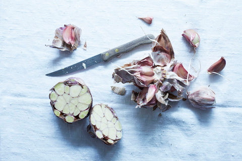 Garlic cloves with knife