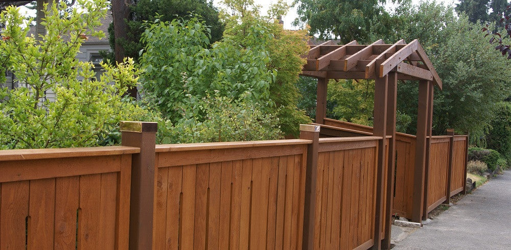 Copper Post Cap Installed on Cedar Fence