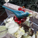 Turquoise blue bird with red berries garden plant stake