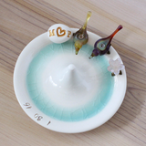 Glass lovebirds and flower and clay egg decorate personalize pottery wedding ring holder