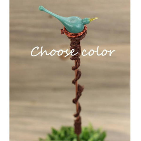 Custom plant stake with handmade blue art glass bird topper
