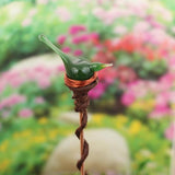 Plant stake with lovely emerald glass bird in nest
