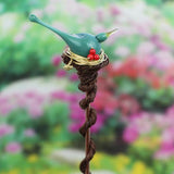 Garden or potted plant stake with turquoise bird topper and red berries