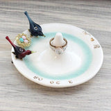 White ceramic ring holder  with glass love birds and family nest, with custom gold monogram