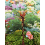 Pretty golden yellow bird in copper nest potted plant or garden stake