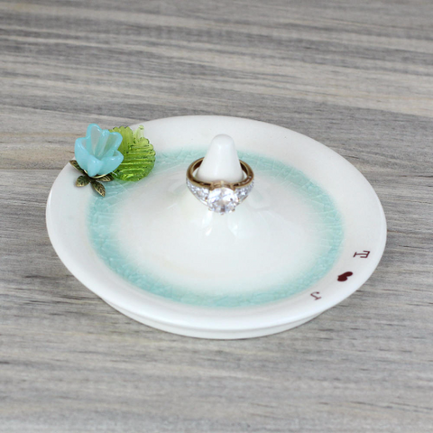 Aqua glass flower and green leaf adorn pottery ring dish