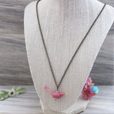 Pink glass bird necklace
