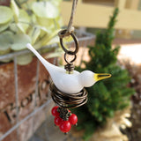Dove holiday tree ornament with red berries