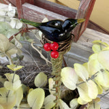 Emerald green bird with red berries plant stake