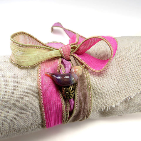 Pink ribbon wrap bracelet with purple art glass bird bead, hand dyed silk ribbon - Elise Thomas Designs