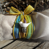 Dove silk wrap bracelet on turquoise & yellow hand dyed ribbon