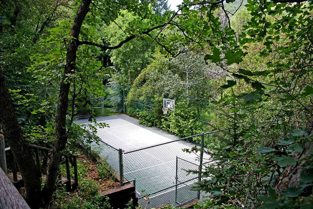 Tennis courts among the trees in Sundance available to those staying at the Chalet Blue Light Resort