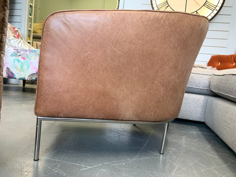 Art deco style curved back accent chair in distressed tan leather