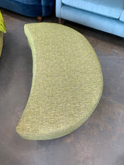 Sutton crescent shaped footstool in green mixed weave fabric