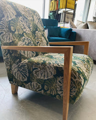 Claudia accent chair with oak arms in fern leaf print fabric