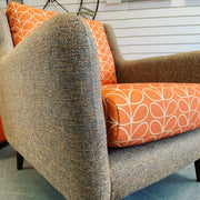 Fern low arm armchair in iconic orange stem flower print fabric RRP £899