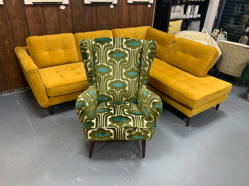 Alma by OK retro wingback chair in green climbing daisy fabric RRP £985
