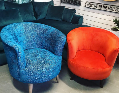 Round tub accent chair in textured blue velvet fabric