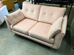 Ella 2 Seater Sofa in baby pink velvet fabric RRP £899