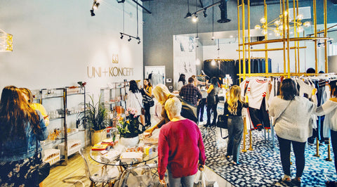 Uni+Koncept uptown waterloo women's lifestyle boutique hosting grand opening event. women shopping at the boutique.