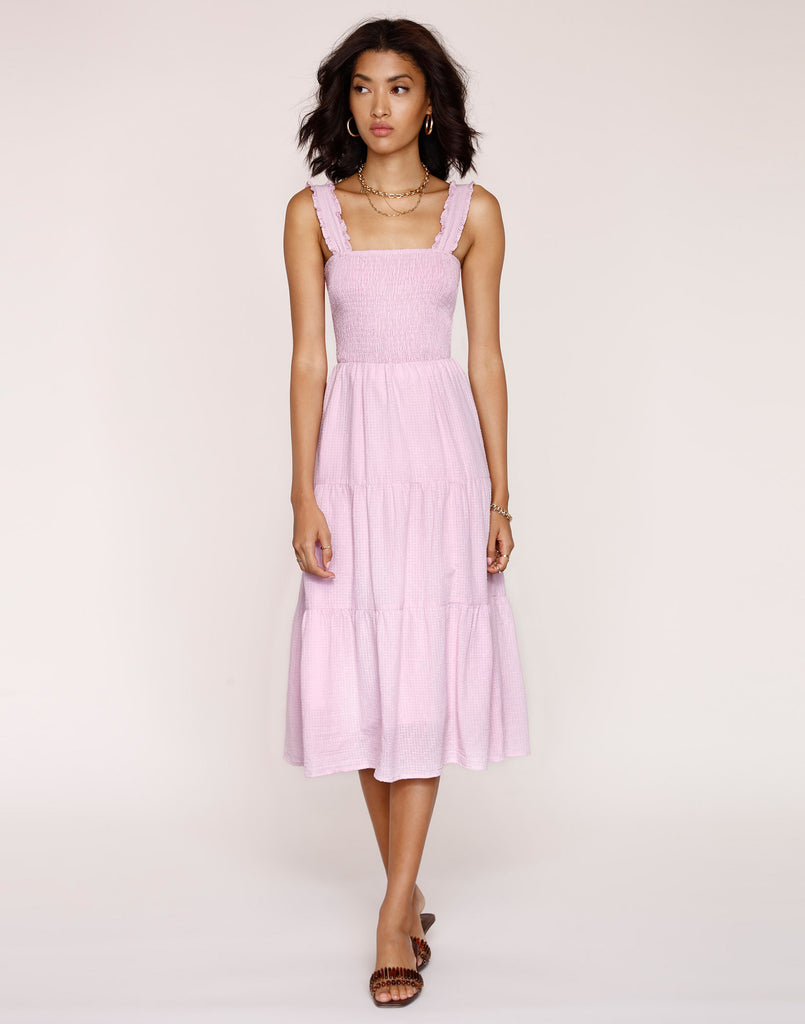UNIKONCEPT LIFESTYLE BOUTIQUE: The model is wearing the Kiera Dress in the peony colour by Heartloom. This dress has a smocked tank top style top with a ruffled trim on the straps and a tiered skirt. You can change the straps around at the back of the dress. It is a midi length.