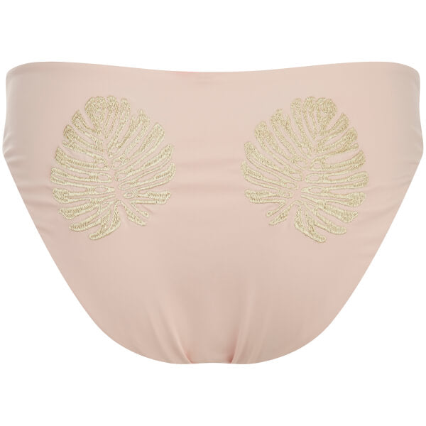 Image shows a Flay lay of the back of Minkpink bikini bottoms in a mid-rise full cut. The gold lure full coverage bottom has a nude colour base with two gold embroidered tropical leaves on the bum.