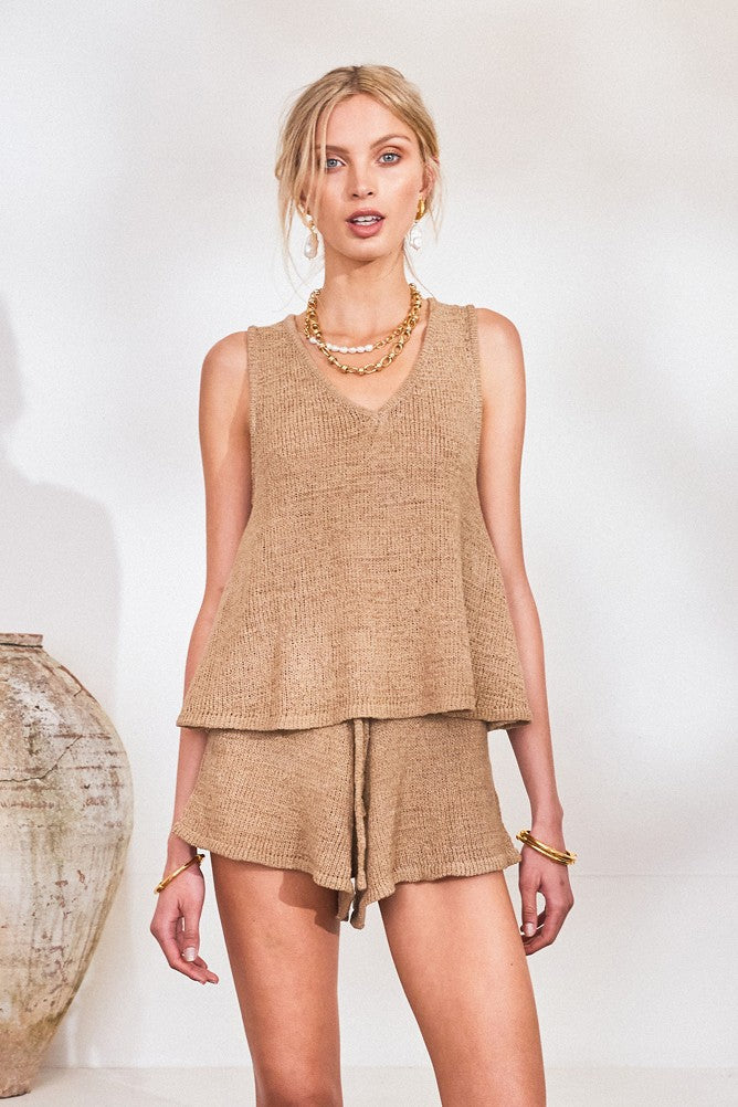 UNIKONCEPT LIFESTYLE BOUTIQUE: The model is wearing the Amy Knit shorts by Lost in Lunar in the colour camel. The shorts are high waisted and slightly flare out at the bottom. They have an elastic waist band with an adjustable tie.