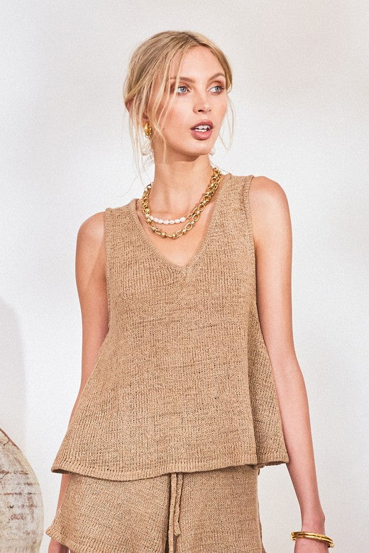 UNIKONCEPT LIFESTYLE BOUTIQUE: The model is wearing the Amy Knit top by Lost in Lunar in the colour camel. The top features a small V neckline and thick straps. This top slightly flares out below the waist.