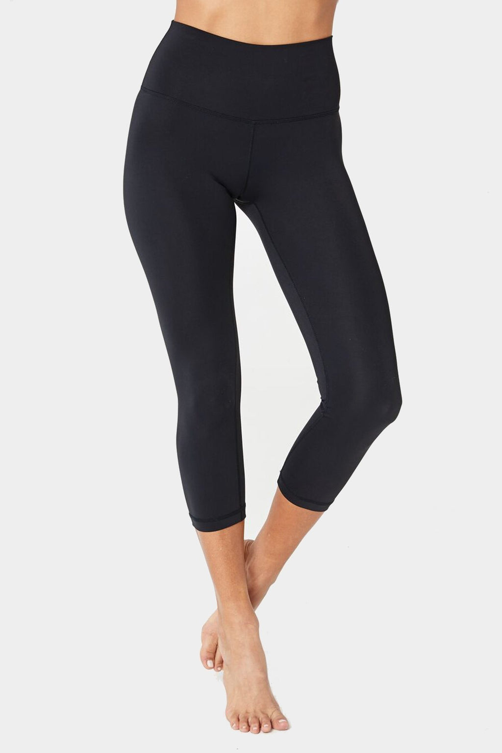Model is wearing black, high waist spiritual gangster leggings. The perfect high waist crop legging are cropped mid-calf.