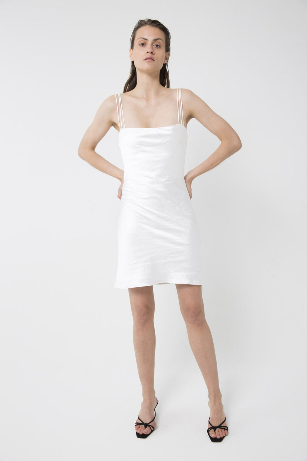 UNIKONCEPT lifestyle boutique: Bridal wear: Model is wearing white, satin, mini third form slip dress. The 90's bias mini slip dress comes with 3 strap detail and square neckline.