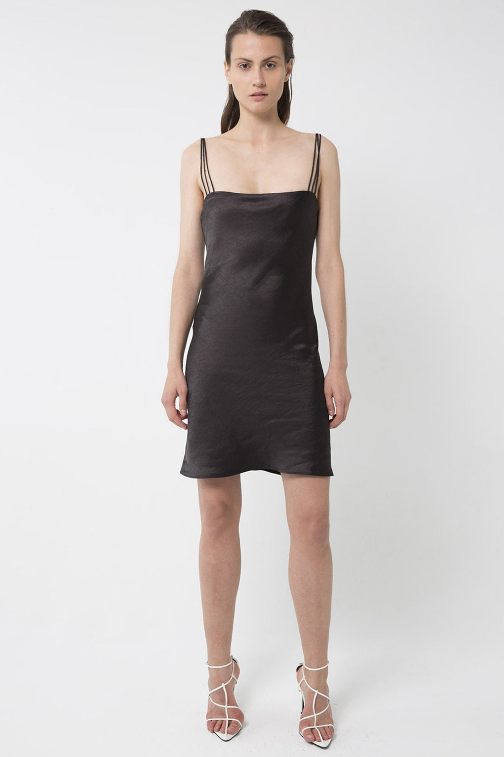 UNIKONCEPT lifestyle boutique: Model is wearing black, satin, mini third form slip dress. the 90's bias mini slip dress comes with 3 strap detail and square neckline.