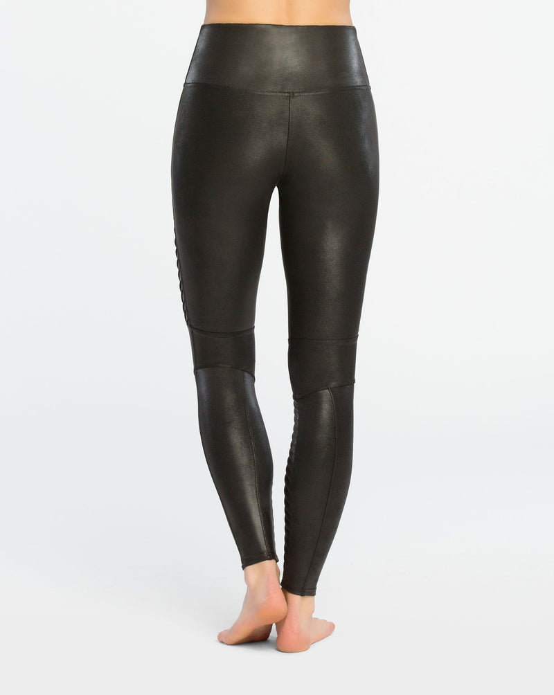 UNIKONCEPT Lifestyle boutique: Model wearing black moto, slimming Spanx leggings in faux leather fabric. The Moto leggings  details include ribbing along legs.
