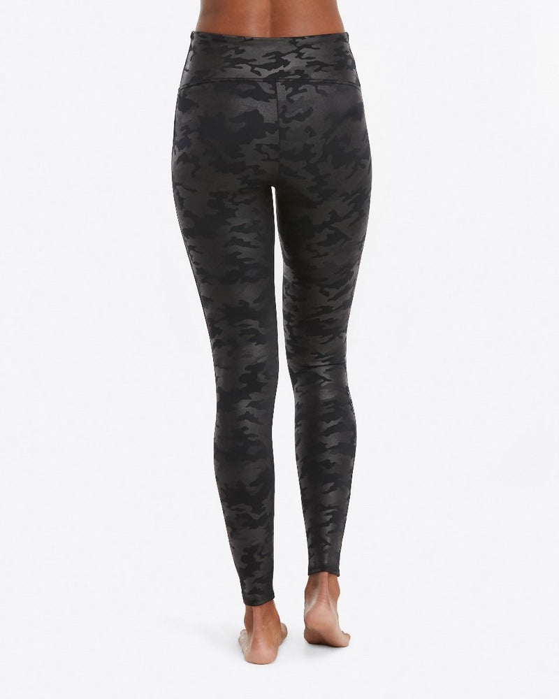 UNIKONCEPT Lifestyle boutique: Model wearing black camo, slimming Spanx leggings in faux leather fabric. Camo detailing throughout leggings.