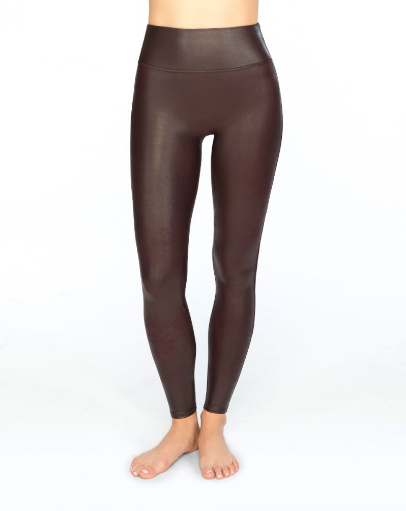 UNIKONCEPT Lifestyle boutique: Model wearing wine (burgundy), slimming Spanx leggings in faux leather fabric.