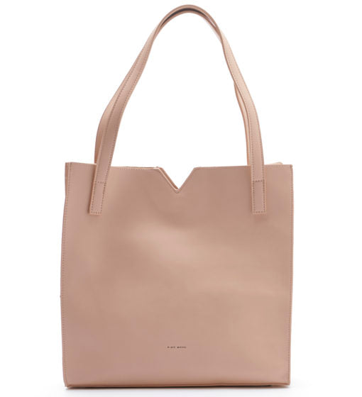 Tan, faux leather soft, pixie mood shoulder bag. The Alicia tote features a small triangle cut out in the middle of the top line. The bag has a small inner pouch that comes with a detachable long strap to be used as a crossbody strap.