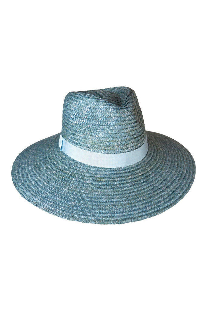 UNIKONCEPT Lifestyle boutique: Image shows the Bologna Fedora in blue by Ace of Something. This fedore is made of woven straw and features a tonal (also blue) ribbon trim.