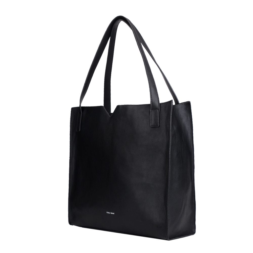Black, faux leather soft, pixie mood shoulder bag. The Alicia tote in black features a small triangle cut out in the middle of the top line. The bag has a small inner pouch that comes with a detachable long strap to be used as a crossbody strap.
