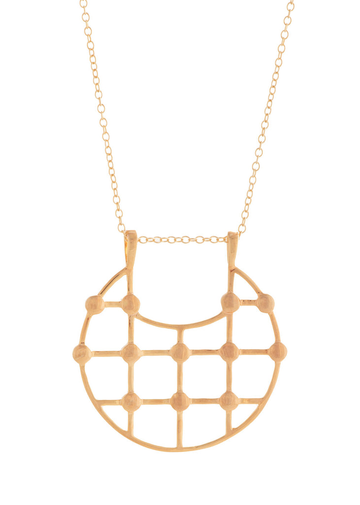 UNIKONCEPT Lifestyle boutique; image shows the Arya Necklace in Gold by Sarah Mulder. This necklace features a grid detailed circular pendant, front facing of a dainty gold chain.