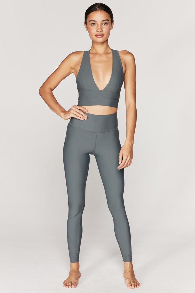 UNIKONCEPT: Lifestyle boutique, Model wears a sleek pair of olive green spiritual gangster leggings. The Tulum legging is an ultra compression high waisted full length olive green legging made for all types of physical activities