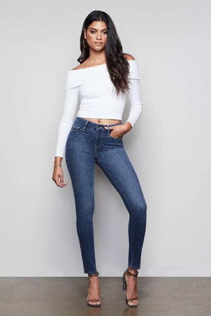 UNIKONCEPT Lifestyle boutique: Image shows the Good Leg Jean by Good American. These dark blue denim skinny jeans are a classic high rise silhouette. The legs are full length and feature a clean cut, classic hem so they can be dressed up or down for any occassion. The denim is slightly acid washed to add dimension.