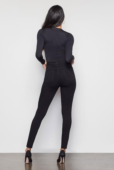 UNIKONCEPT Lifestyle boutique: Model wears a pair of black Good American denim. The Good Waist denim is made for accentuating a smaller waist and a shapely bum .