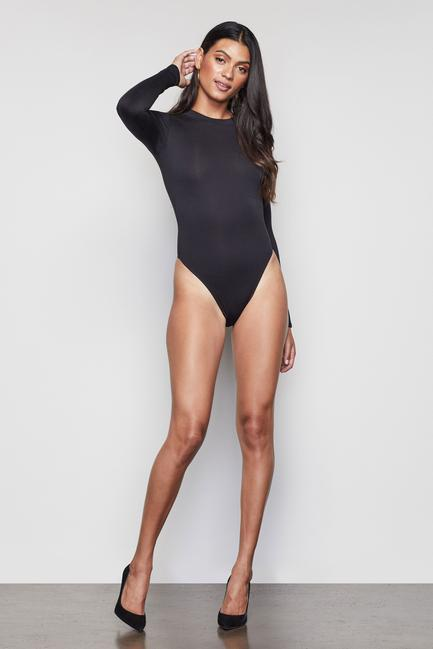 UNIKONCEPT Lifestyle boutique: image shows the Crewneck Bodysuit by Good American in black. This fitted, long-sleeve, crew neck style bodysuit is a staple in your wardrobe. Featuring a button clasp along the underwear portion of the bodysuit, it can be put on or removed extremely easily.