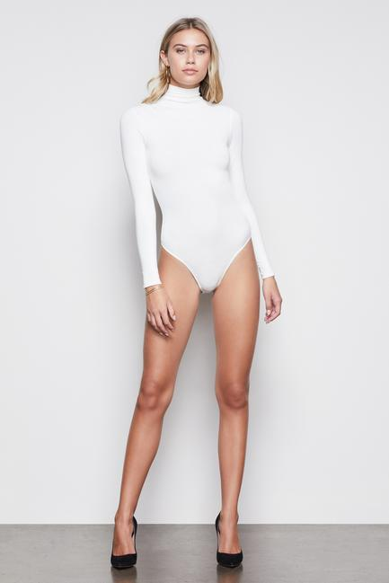 UNIKONCEPT: Lifestyle boutique; Image shows a turtle neck bodysuit by Good American. The coverup turtleneck bodysuit in ivory, is a long sleeved bodysuit that features a thong like bottom portion to ensure comfort and free of lines in any bottoms.