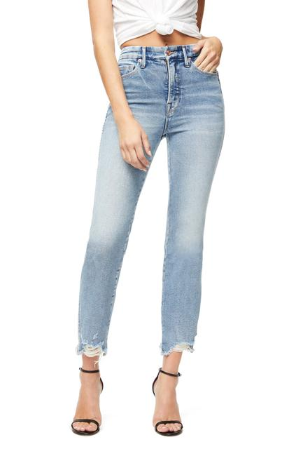 UNIKONCEPT Lifestyle boutique: Model is wearing the Good American Good Curves Fray Denim. The Good Curves Fray are a light blue, high waist denim that feature lighter wash with frayed bottom edges.