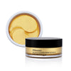 Gold under eye patches and glass container with a black lid.