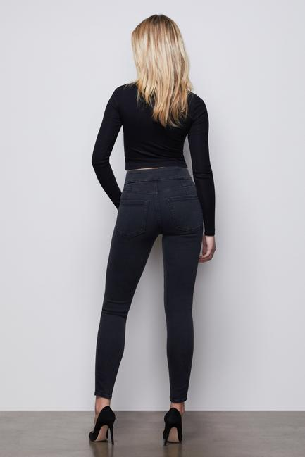 UNIKONCEPT Lifestyle boutique: Image shows the Good Waist jean in a black denim by Good American. This pair of Good Waist jeans are super high rise, which is accentuated by an exposed button fly with gold accented button closures. The Good Waist denim is a skinny jean made for accentuating a smaller waist and a shapely bum.