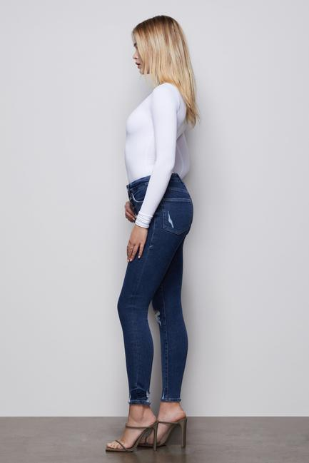 UNIKONCEPT Lifestyle boutique: image shows the Good Waist Exposed button jeans in a medium blue denim by Good American. This pair of Good Waist jeans are super high rise, which is accentuated by an exposed button fly with silver accented button closures. The Good Waist denim is a skinny jean made for accentuating. smaller waist and shapely bum. This denim has minimal distressing details.