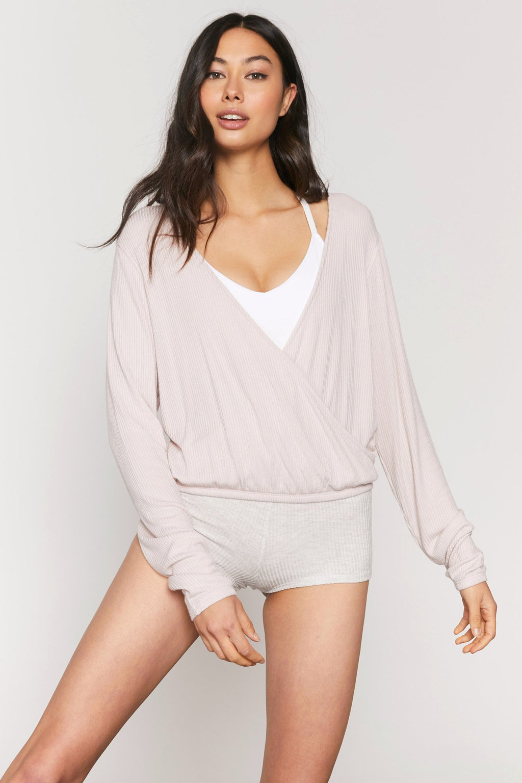 UNIKONCEPT: Lifestyle boutique; Image shows a long sleeve rose coloured ribbed cropped top. The ballet ribbed surplice top features an elastic waistband and a faux wrap top.